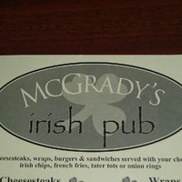 Photo taken at McGrady's Irish Pub by Eirini T. on 9/8/2012