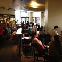 Photo taken at Starbucks by Marcos N. on 5/19/2012