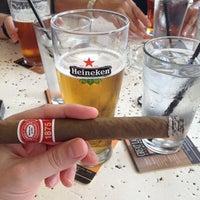 Photo taken at Fado Irish Pub & Restaurant by Scott G. on 6/24/2012
