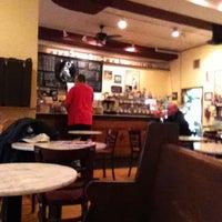 Photo taken at Unicorn Café by Tom O. on 4/25/2012
