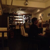 Photo taken at bar cacoi by Naohiro on 5/5/2012