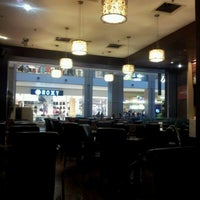 Photo taken at Theobroma Chocolate Lounge by Julia D. on 5/16/2012