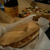Photo taken at Yellow Cab Pizza Co. by Benson S. on 3/8/2012