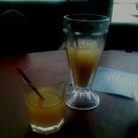 Photo taken at Banana's Café by Rojita B. on 9/11/2012