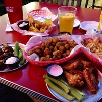 Photo taken at Pluckers Wing Bar by Kevin T. on 7/20/2012