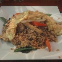 Photo taken at Thai Basil Restaurant by Susana R. on 2/21/2012
