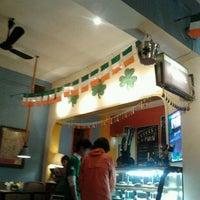 Photo taken at Puku Café & Sports Bar by Meehee N. on 3/16/2012