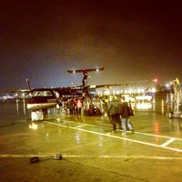 Photo taken at Gate F19 by M. Elizabeth H. on 2/17/2012
