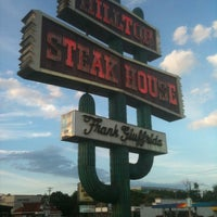 Photo taken at Hilltop Steakhouse by Tyler H. on 7/8/2012