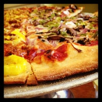 Photo taken at Brick Road Pizza Co. by Ashley H. on 4/6/2012