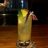 Photo taken at Voodoo Tiki Bar & Lounge by Joli E. on 6/7/2012