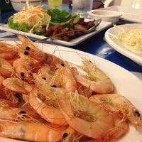 Photo taken at Nathong Restaurant by Benjawan S. on 3/28/2012