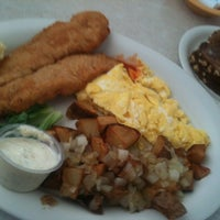 Photo taken at Suntree Café by Shane B. on 3/27/2012