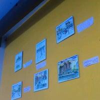 Photo taken at Umi Café by Waldo O. on 2/11/2012