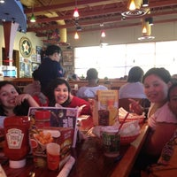 Photo taken at Red Robin Gourmet Burgers by April T. on 3/17/2012