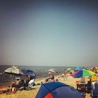 Photo taken at Sea Street Beach by Alex M. on 7/11/2012