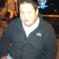 Photo taken at The Blue Bull Bar & Grill by Ryan H. on 3/11/2012