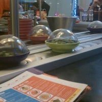 Photo taken at YO! Sushi by Angelina U. on 5/19/2012