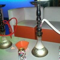 Photo taken at Tangerine Hookah Lounge by Kasey A. on 3/9/2012