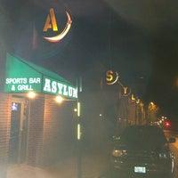 Photo taken at Asylum Sports Bar Grill & Nightclub by Joshua B. on 3/15/2012