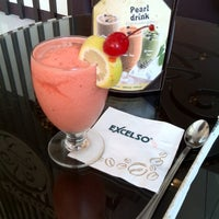 Photo taken at EXCELSO Café by Lovable U. on 6/29/2012