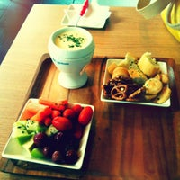 Photo taken at Capstone Tea & Fondue by Christina P. on 6/30/2012