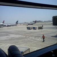 Photo taken at Gate 58A by Nadia A. on 5/11/2012