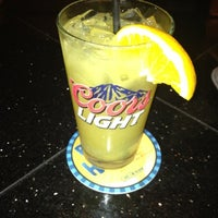 Photo taken at Dogtooth Bar & Grill by Angela T. on 8/1/2012