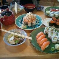 Photo taken at Momo Sushi & Cafe by Annya E. on 2/29/2012