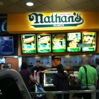 Photo taken at Nathan's Famous by Guy T. on 3/14/2012