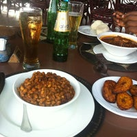 Photo taken at Ghanaian Village Restaurant by Tayo S. on 5/5/2012