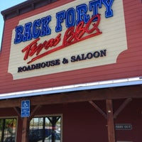 Photo taken at Back Forty Texas BBQ Roadhouse & Saloon by Anthony V. on 7/21/2012