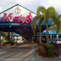 Photo taken at Monty's Fish and Stone Crab Restaurants by Greg W. on 2/4/2012