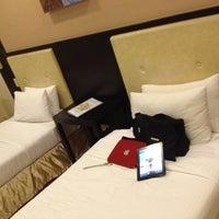 Photo taken at New Horizon Hotel by Neil E. on 2/26/2012