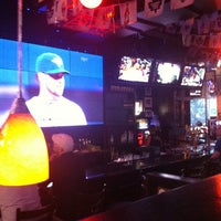 Photo taken at Hoops Sports Bar & Grill- Bremner by Chelsea C. on 5/16/2012