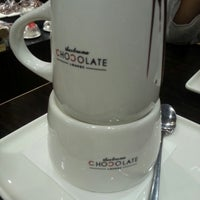 Photo taken at Theobroma Chocolate Lounge by Evalia C. on 9/5/2012