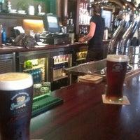 Photo taken at Tigín Irish Pub and Restaurant by Michael B. on 7/25/2012