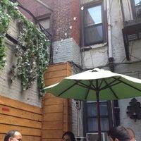 Photo taken at Garlic New York Pizza Bar by Leah K. on 6/14/2012