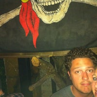 Photo taken at Treasure Island Bar by Ashley Z. on 3/17/2012