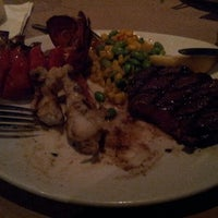 Photo taken at Bonefish Grill by Jamaal T. on 8/3/2012