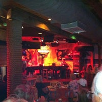 Photo taken at Rum Runners Dueling Piano Bar by Lauren P. on 3/25/2012
