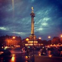 Photo taken at Place de la Bastille by Sacha C. on 5/30/2012