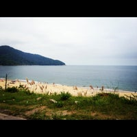 Photo taken at Praia de Boiçucanga by Izabel P. on 2/19/2012