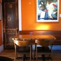 Photo taken at Namaste Cafe by Kristine B. on 4/19/2012