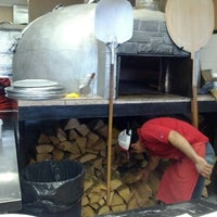 Photo taken at Dino's Wood Burning Pizza by kris y. on 4/10/2012