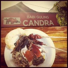 Photo taken at Babi Guling Candra by Benny S. on 2/15/2012