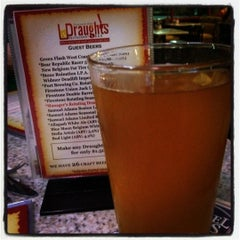 Photo taken at Draughts Restaurant & Bar by Diane on 2/8/2012