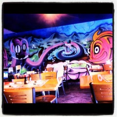Photo taken at Sipz Fusion Cafe by Jesse G. on 5/18/2012