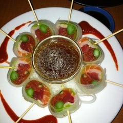 Photo taken at RA Sushi Bar Restaurant by Fernanda B. on 2/17/2012