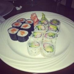Photo taken at Manu's Tapas Bar & Sushi Lounge by Joan on 8/9/2012
